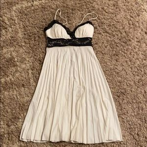 Fit and flare cream and black dress